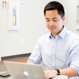HealthVerity team member working on a laptop